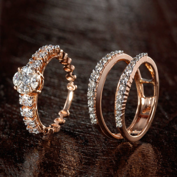 Detachable Rose Gold and Diamond Twin Ring on a Brown wooden base