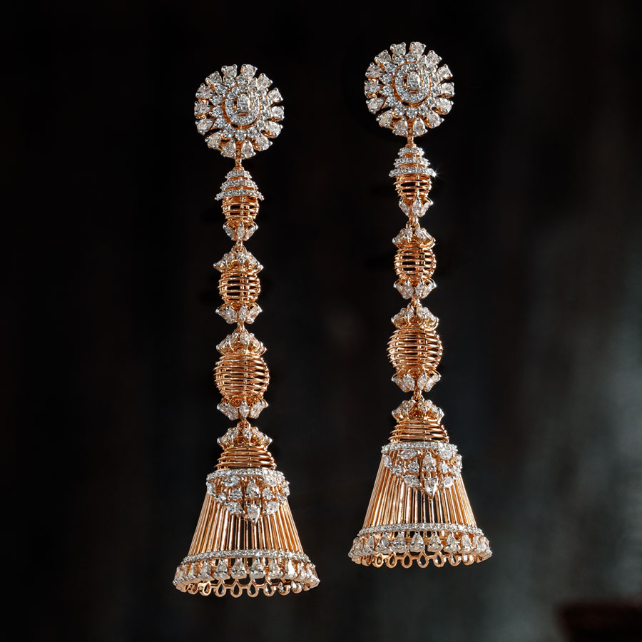 Rose Gold and Diamond Jhumkis on a dark background