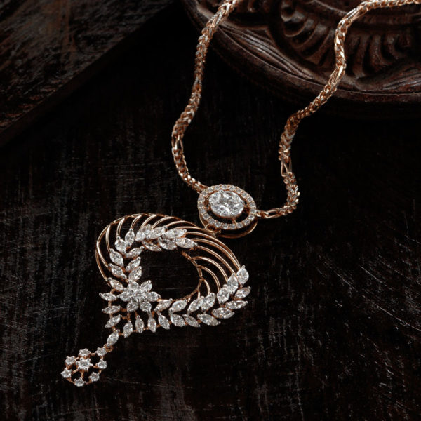 Rose Gold and Diamonds Pendant with a rose gold chain on dark brown wooden background