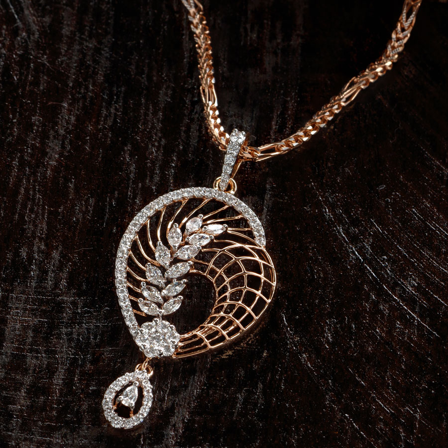 Diamond and Rose Gold Regal Pendant on a brown wooden background