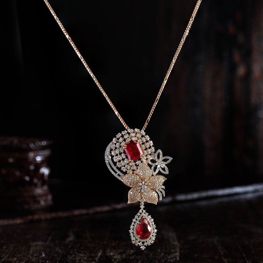 Floral Ruby, Diamonds and Rose Gold Pendant Suspended from a chain