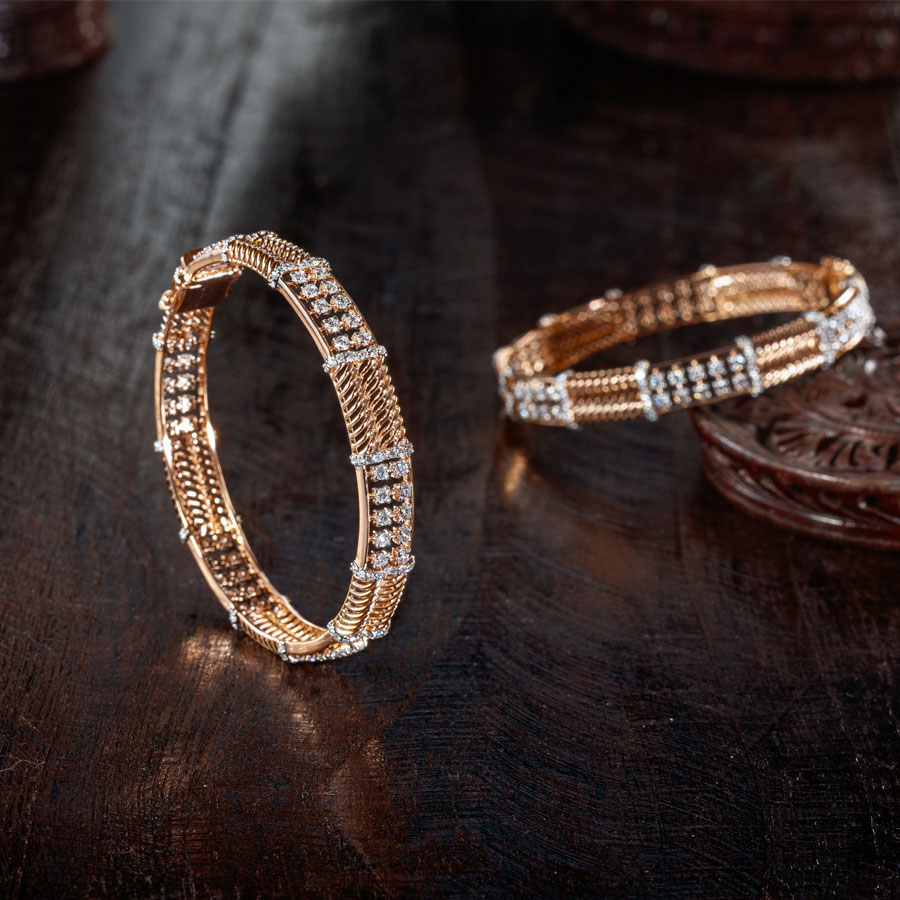Diamond Bangles placed on a brown, wooden base