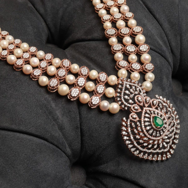 Diamond, Pearls and Emerald Ornamental Necklace on a black cushion background