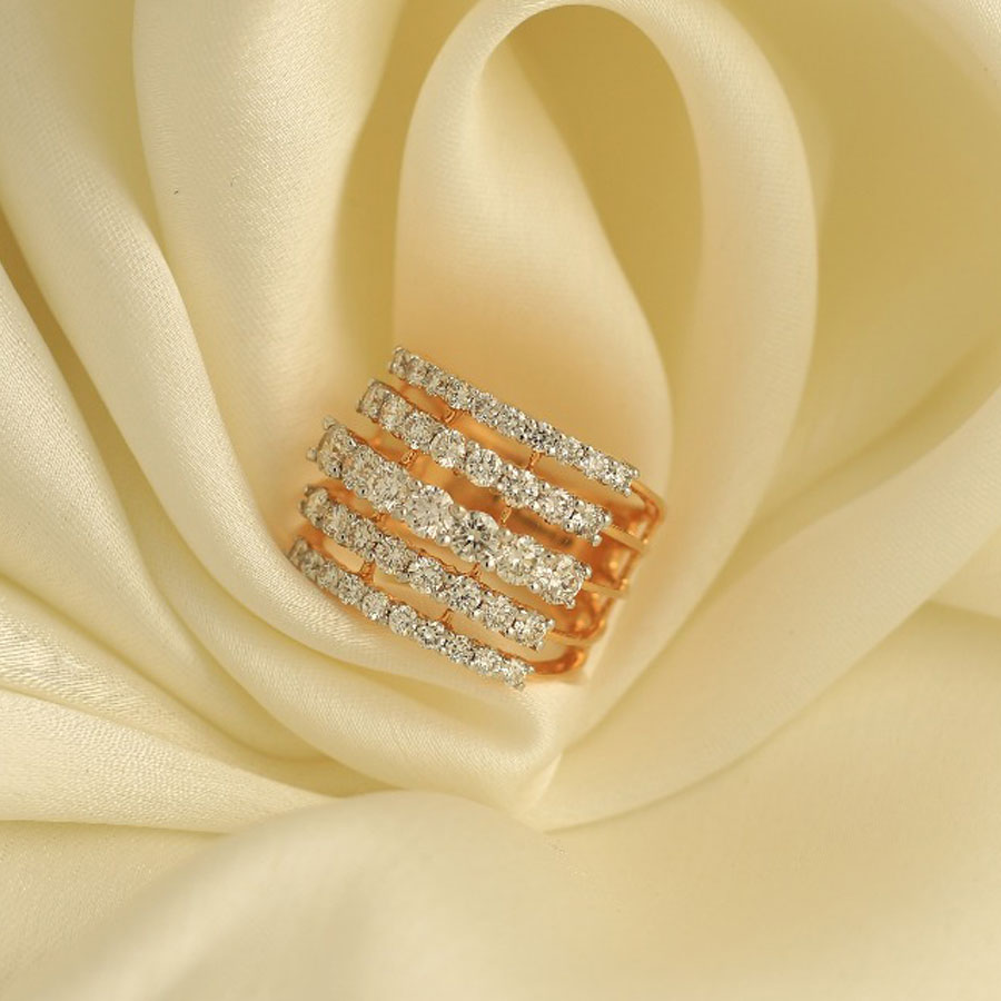 Diamond and Rose Gold Spiral Ring on an off white silk background