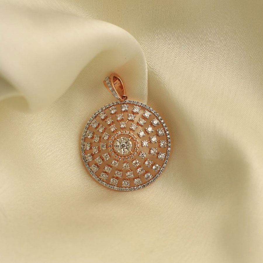 Rose Gold and Diamonds Spiral Pendant on a white silk background