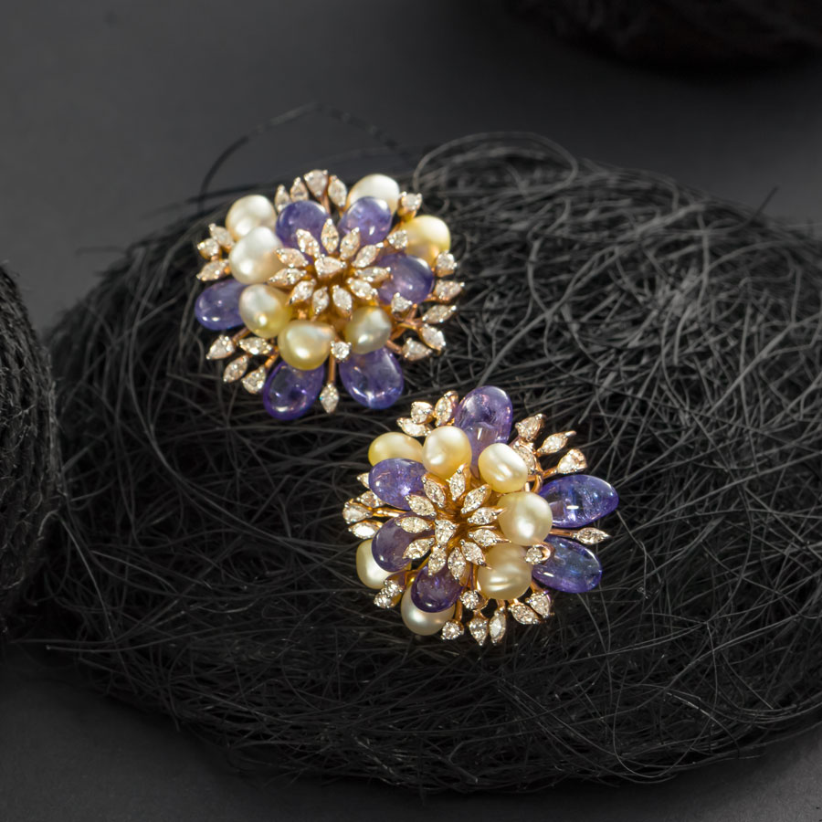 Purple and White Pearls and Diamond Floral Earrings on a dark background
