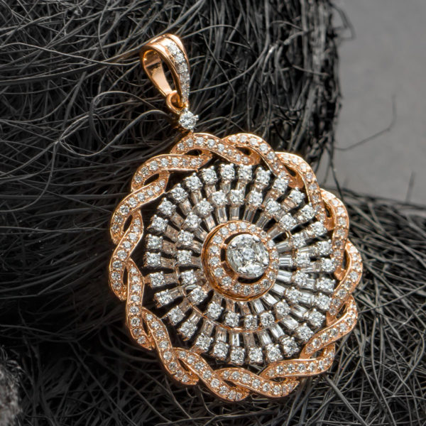 Rose Gold Coiled Diamond Pendant placed on a ball of black thread