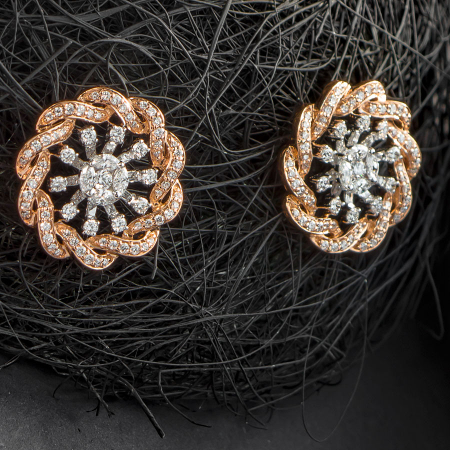 Coiled Rose Gold and Diamonds Earrings on a ball of black thread