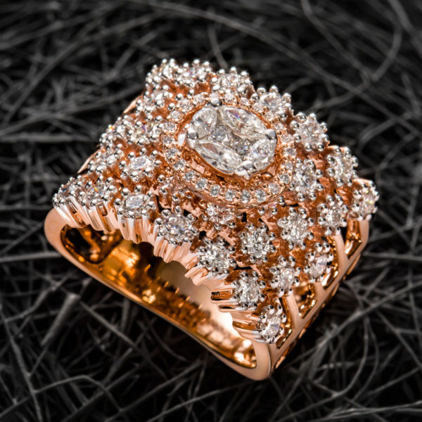 Curled Rose Gold and Diamond Ring on a dark background
