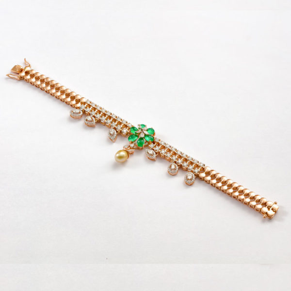 Diamond and Emerald Floral Bracelet on a white background