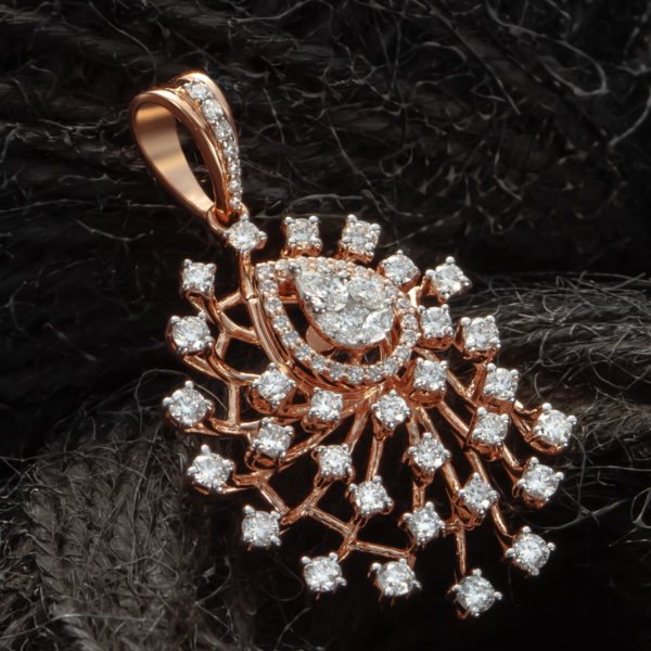 Rose Gold and Diamond Pendant on a dark surface