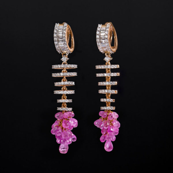 Diamond and Rose Gold Sapphire Drop Earrings on a black background