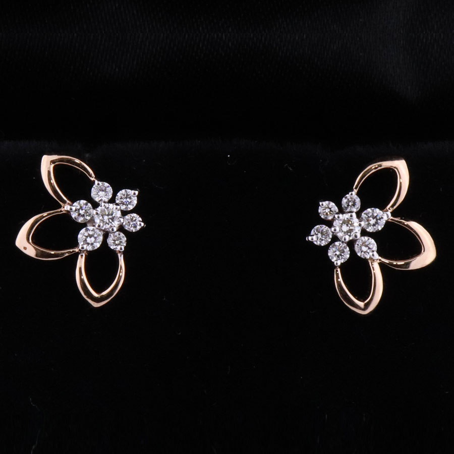 Lily Shaped Rose Gold and Diamond Earrings on a black background
