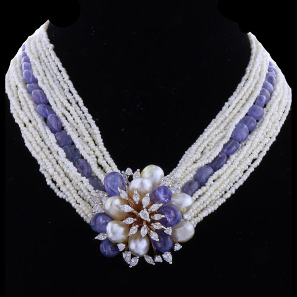 Blue and White Pearls and Diamonds Necklace on a black background