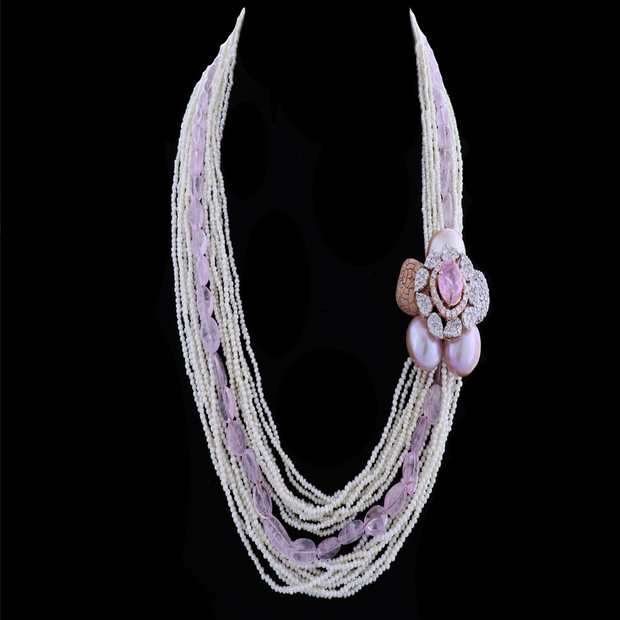 Pear strings and diamond and pearls floral motif necklace on black background