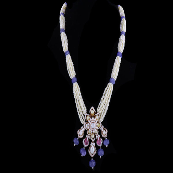 White and Purple Floral Pearls and Diamond Pendant on a black background