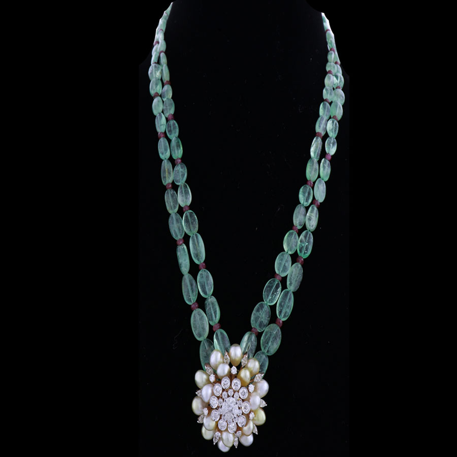 Emerald Green Pearls Necklace with Gems and Diamonds Pendant on a black background