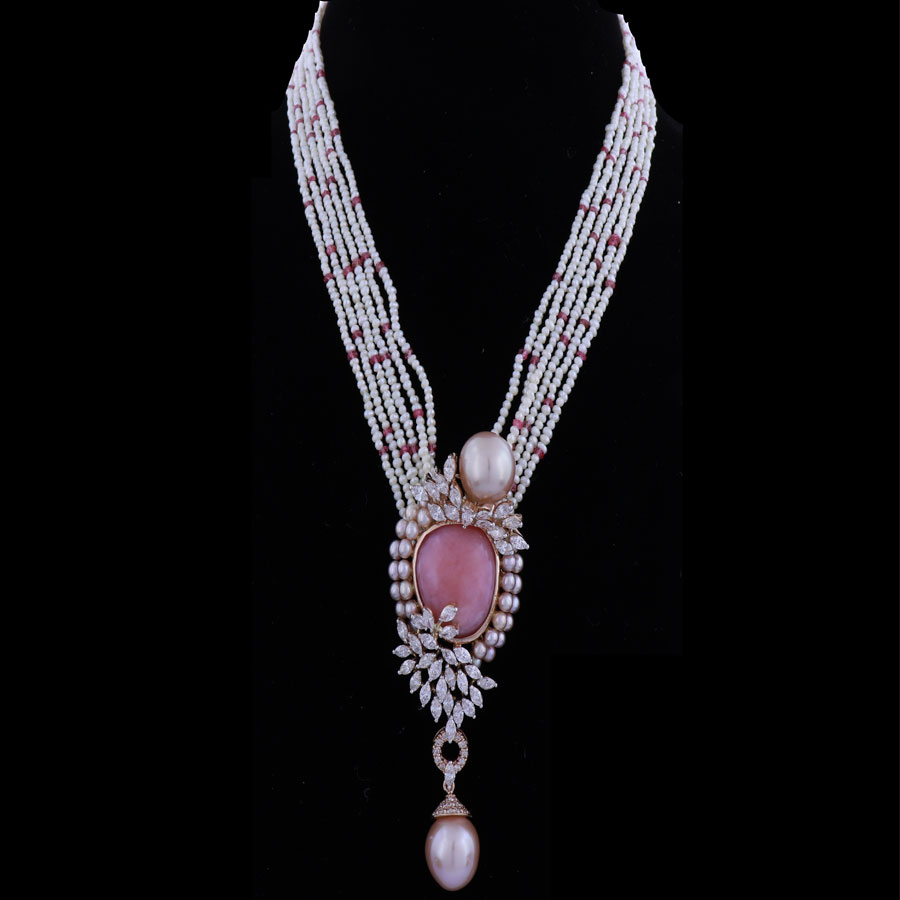 Baby Pink Pearls and Diamond Necklace on a black background