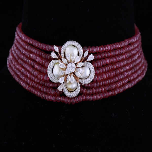 Red Beads and Pearls with Diamonds Floral Choker on a Black background