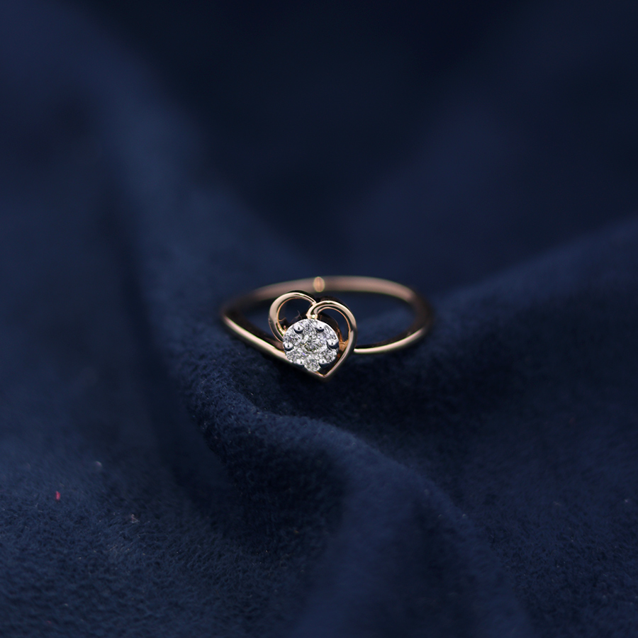 real diamond heart ring on dark blue suede fabric