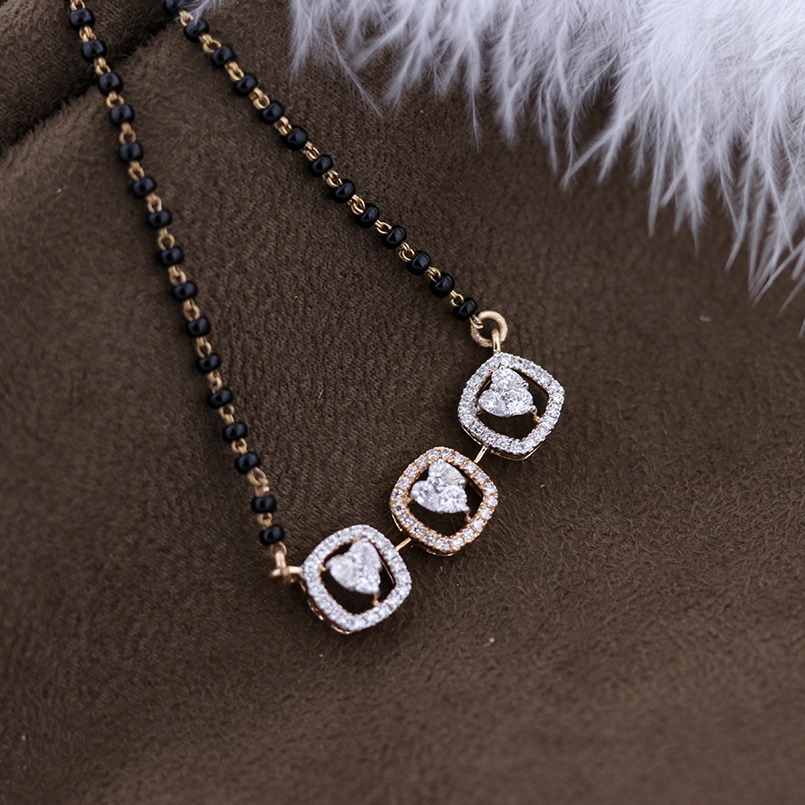 heart shaped diamond troika pendant on a black beads chain and dark background