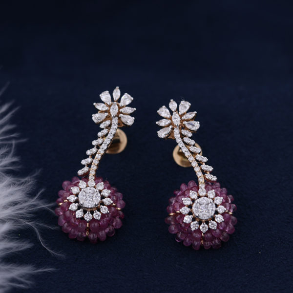 Floral White and Purple Diamond Earrings in a dark blue background